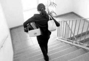 Decorative Image - Woman Leaving her workplace with all of her items.