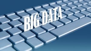Descriptive Image: Keyboard with the words: Big Data hovering over it.