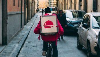 Descriptive Image: Foodora Delivery Man on Bike